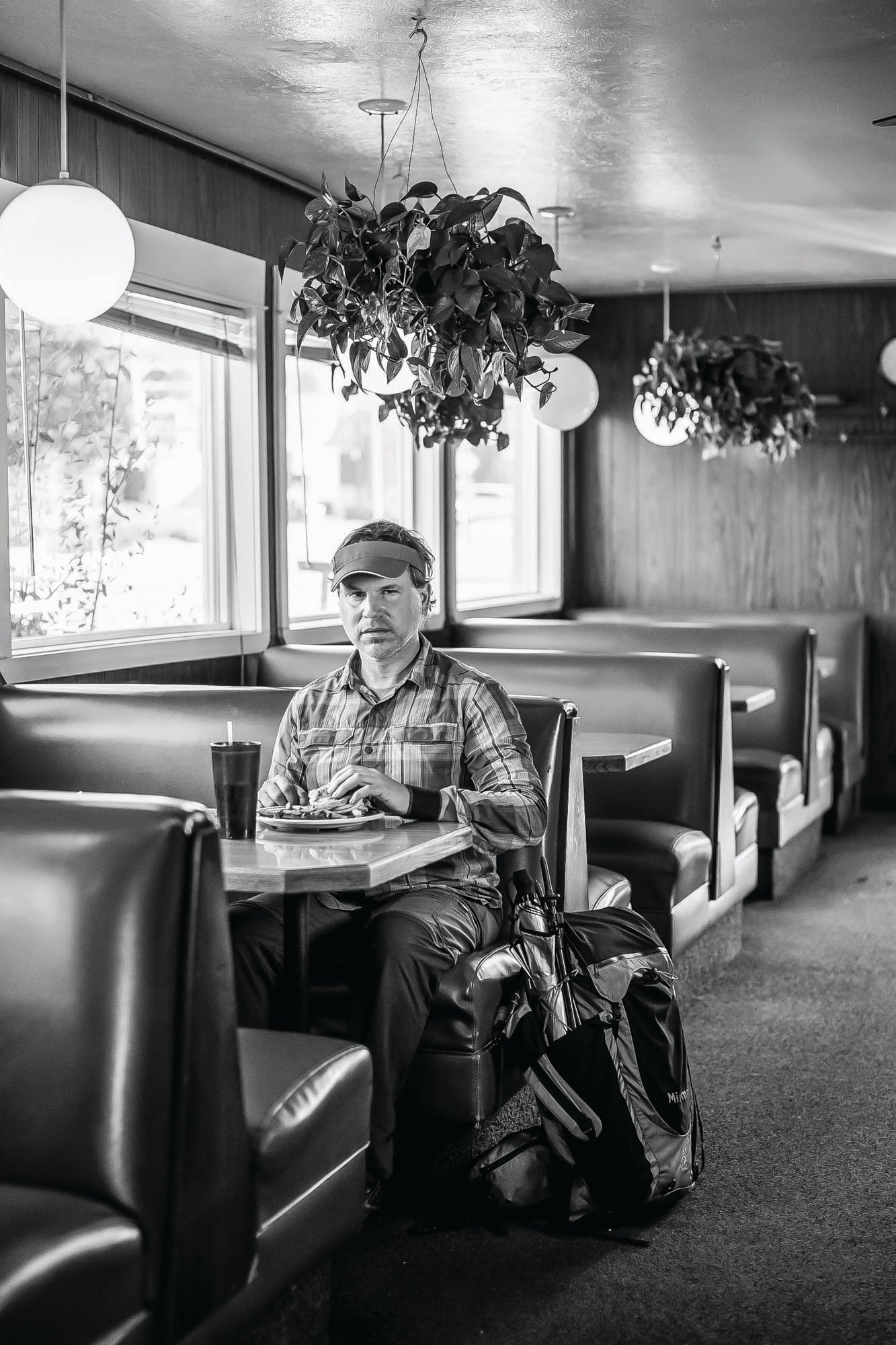 Hiker Rue McKenrick sitting in a diner